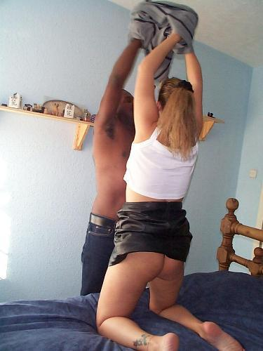 blond girl and black guy getting naked